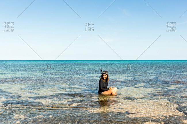 Woman snorkeling in the ocean off of Australia