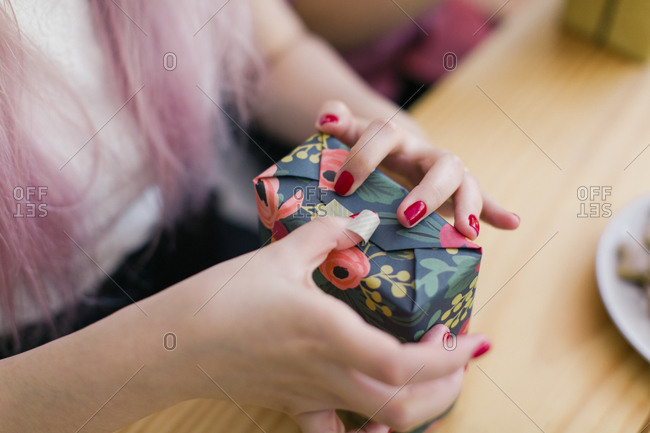 Detail of a woman wrapping Christmas presents