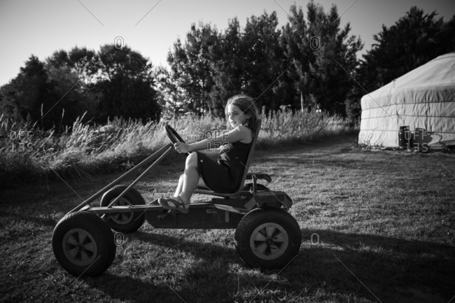 Girl riding on go kart at campground