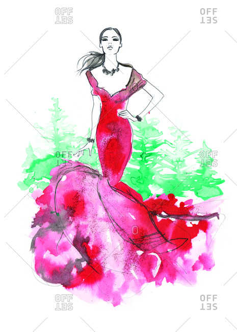 Woman in red dress posing in front of evergreen forest