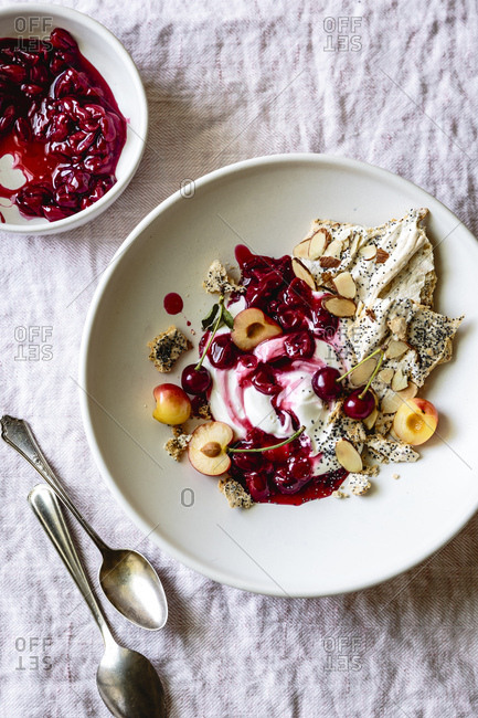 Cherry eton mess with poppyseed almond meringues