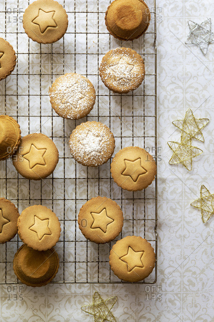 Individual fruit mince pies each with a star shape on top.