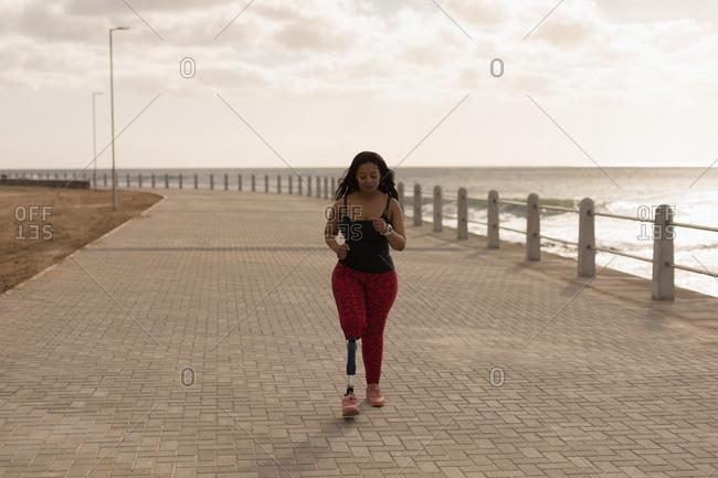 Beautiful disabled woman walking on promenade