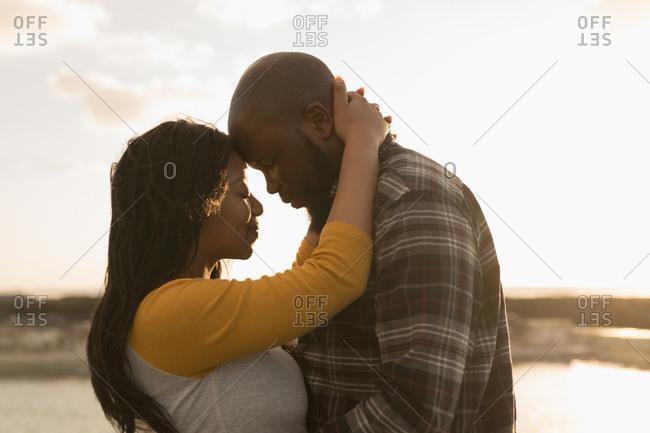 Romantic couple embracing on beach