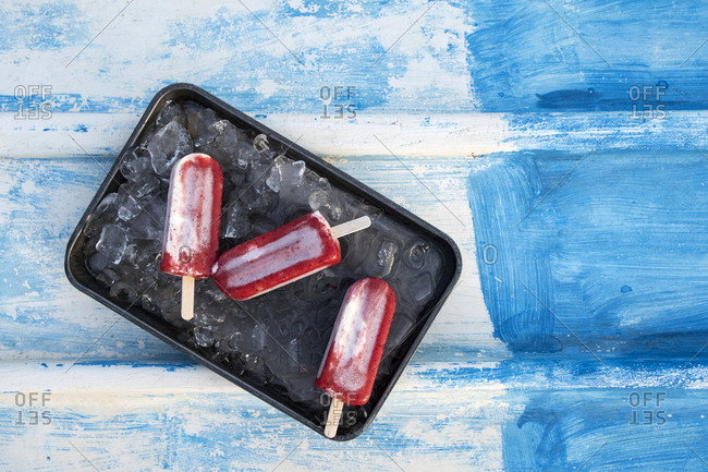 Red popsicles on a tray