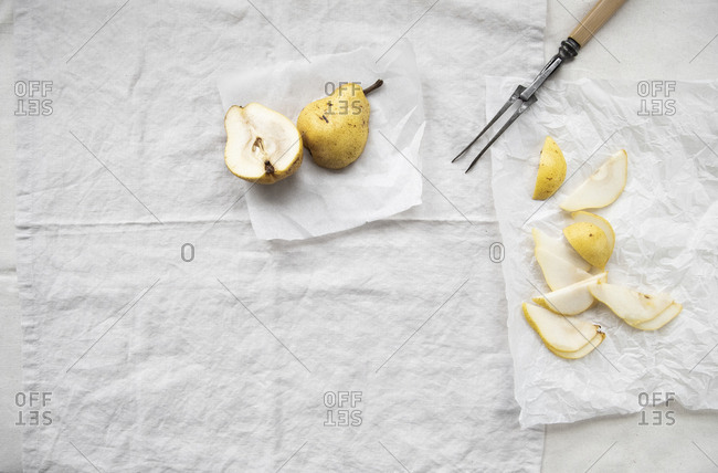 Sliced pear on parchment paper