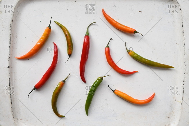 Colorful peppers on white background