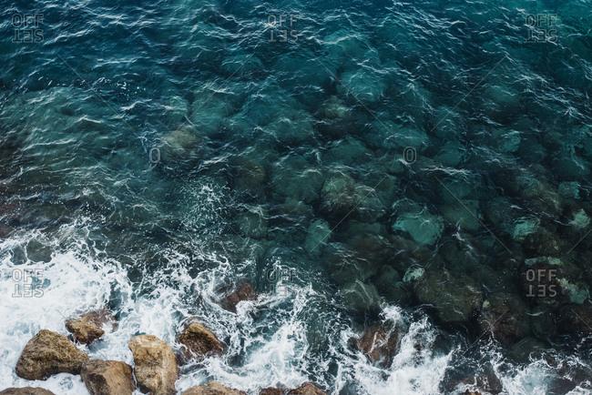 Waves crashing against rocky shoreline