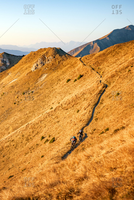 Two mountain bikers seen on a trail of the Gamskarkogel mountain in the Gastein Valley in Austria.