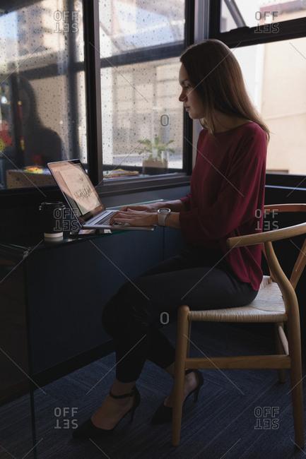 Beautiful businesswoman using laptop in office