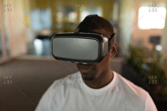 Close-up of business executive using virtual reality headset in office