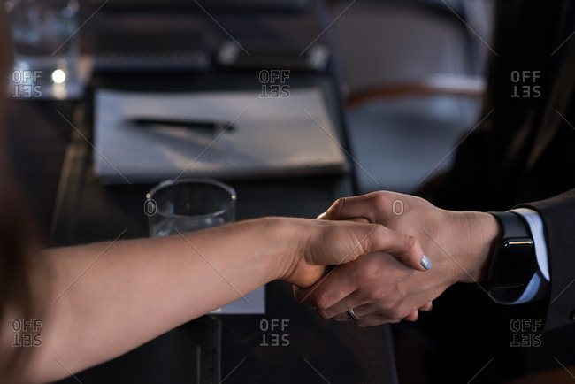Close-up of business people shaking hand with each other