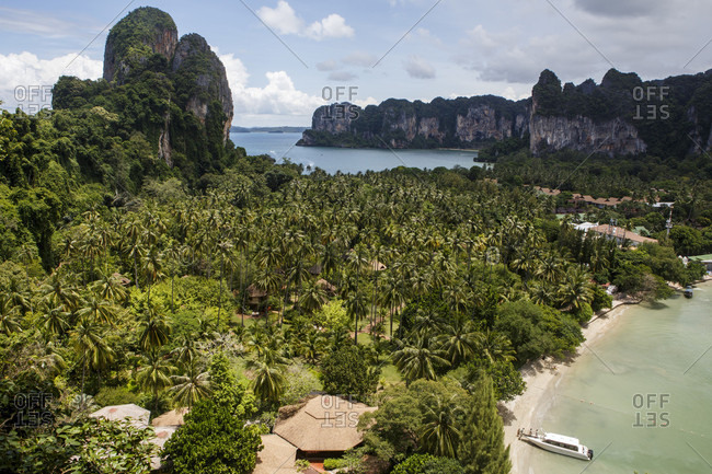 Railay Beach is a popular tourist destination near Krabi, Thailand on the Andaman Sea. Accessible only by boat, the beach includes a number of high end resorts for tourists from around the world.