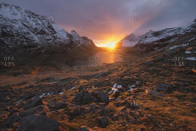 Winter landscape at sunrise of coastline and mountains, Vindstad, Moskenesoya, Lofoten Islands, Norway