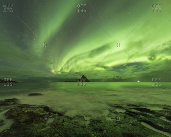 Beautiful natural landscape with aurora borealis over sea, Bleikoya, Bleik, Vesteralen, Norway