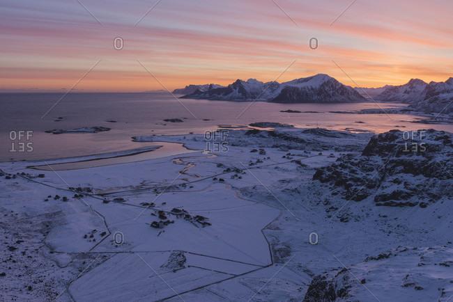 Scenic landscape with winter sunrise over Fredvang and Yttersand beach, Moskenesoya, Lofoten Islands, Norway