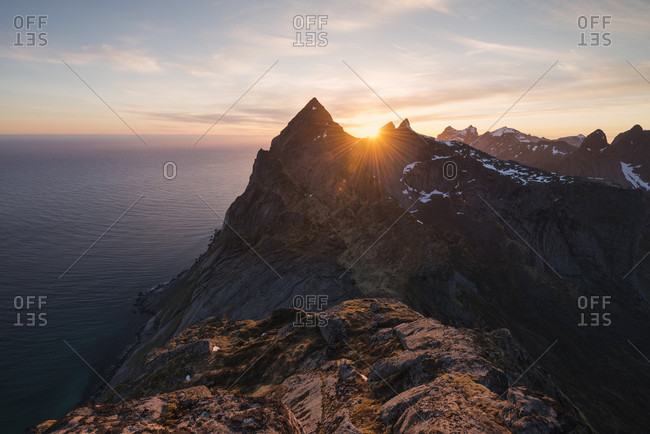 Scenic landscape with mountains of Moskenesoya from Helvetestind and sea, Lofoten Islands, Norway
