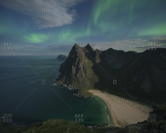 Majestic landscape with aurora borealis over Horseid beach, Moskenesoya, Lofoten Islands, Norway
