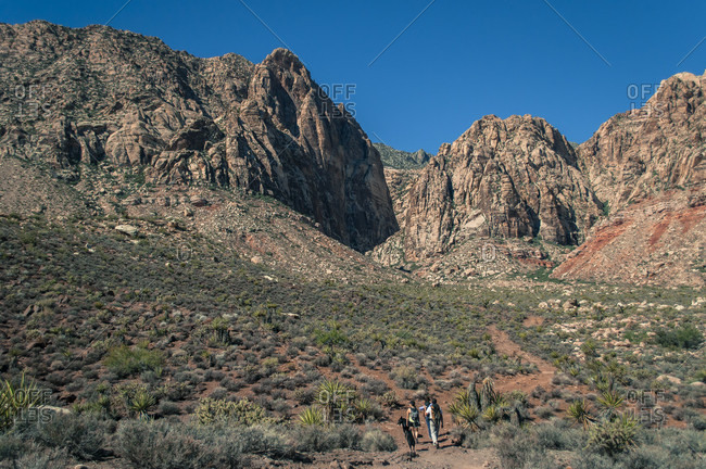 Distant view of group of people?walking?towards canyon in Red Rock Canyon National Conservation Area, Nevada, USA