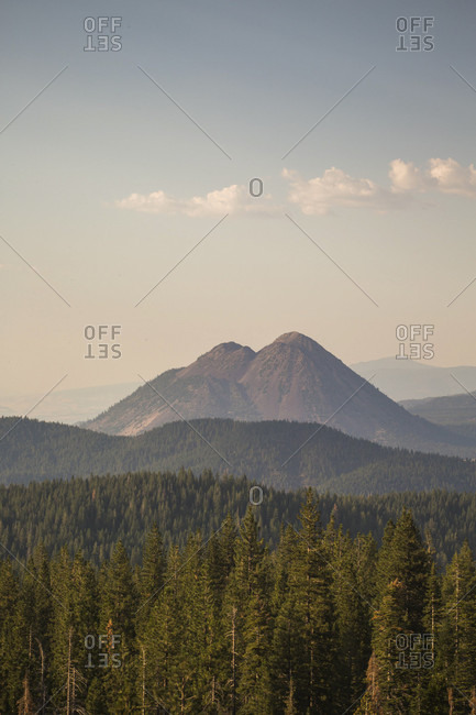 A long view over forested mountains under a hazy blue sky, Shasta, California, USA