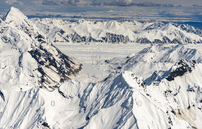 Majestic natural scenery with aerial view of snow-covered Alaska Range in Denali National Park, Alaska, USA