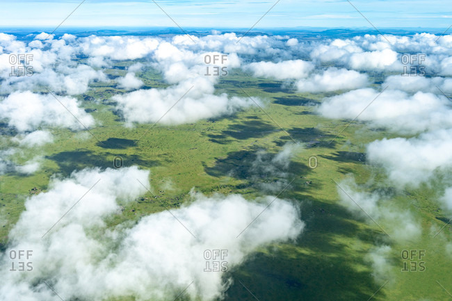 Aerial view above clouds of plains of Serengeti National Park, Gorongoro District, Tanzania