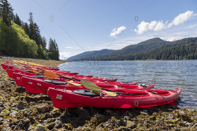 May 31, 2018: Double kayaks sitting on the shore in Sitkoh bay, southeast Alaska, USA