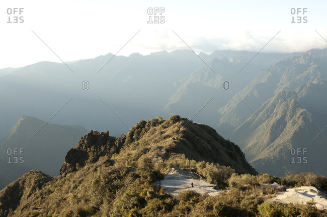 Hiker Takes in View of Andes Mountains, Peru