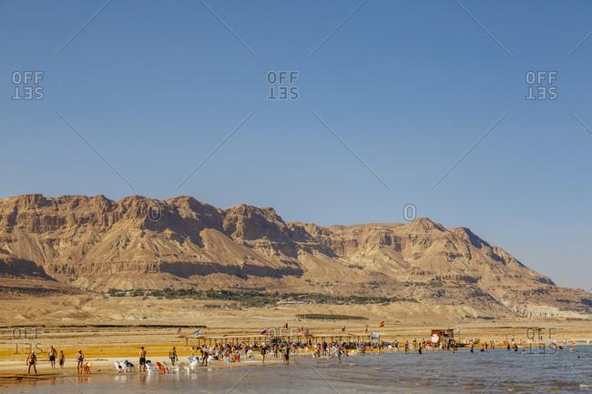 Ein Gedi, Israel - October 11, 2017: People at the Ein Gedi beach, Dead Sea, Israel