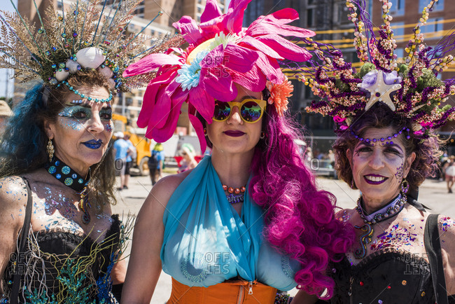 New York City, NY, USA - June 16, 2018: Three women at the Mermaid Parade, Coney Island, Brooklyn