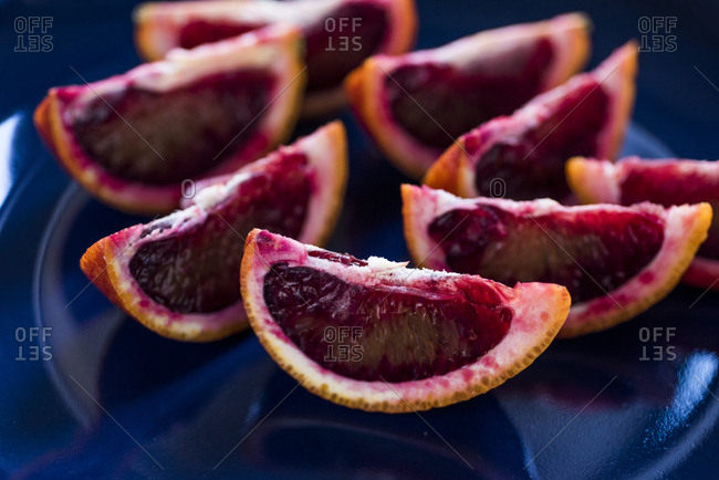 Juicy blood orange slices on plate