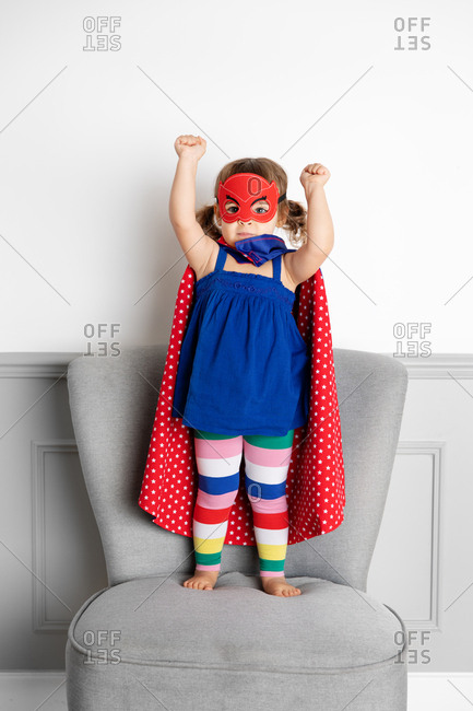 Little girl dressing up as a superhero