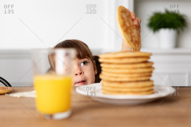 Girl grabbing a pancake