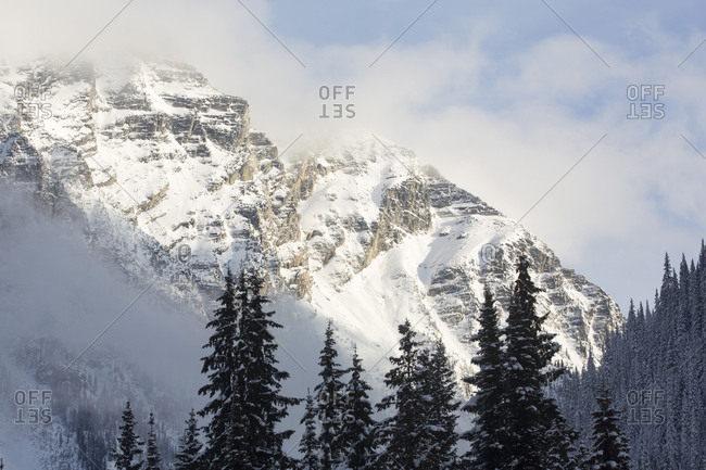 Scenic view of Roger's Pass mountain in morning mist