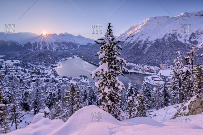 Sunrise over village and Lake of St. Moritz covered with snow, Engadine, Canton of Graubunden, Switzerland, Europe