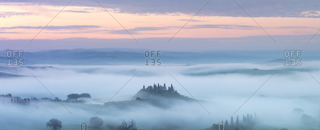 May 10, 2018: Podere Belvedere and mist at sunrise, San Quirico d'Orcia, Val d'Orcia, UNESCO World Heritage Site, Tuscany, Italy, Europe