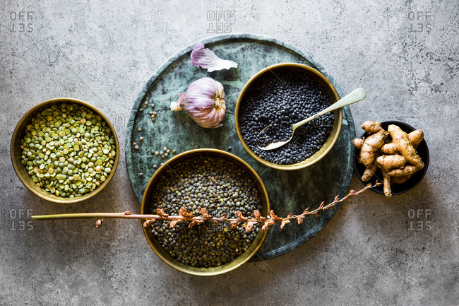 Bowls of puy lentils and turmeric