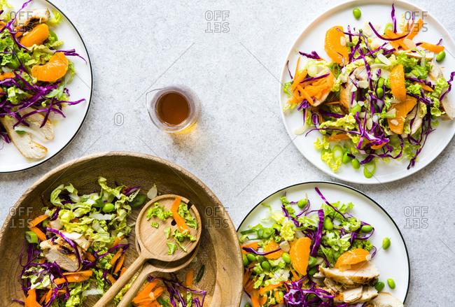 Overhead view of plates of mandarin salad