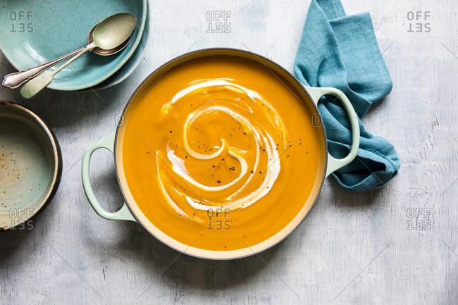 Overhead view of vegetarian pumpkin and yogurt soup