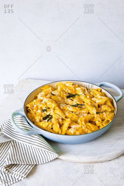 Bowl of penne pasta with pumpkin sauce