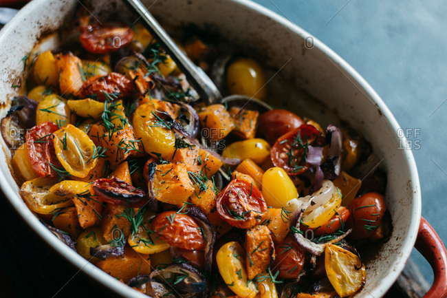 Vegetable stew with pumpkin, tomatoes and red onion
