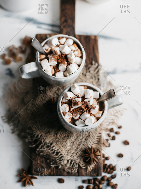 Two mugs of delicious hot cocoa with marshmallows