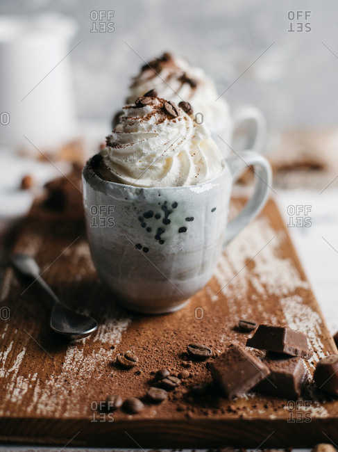 Mug of delicious hot cocoa with whipped cream