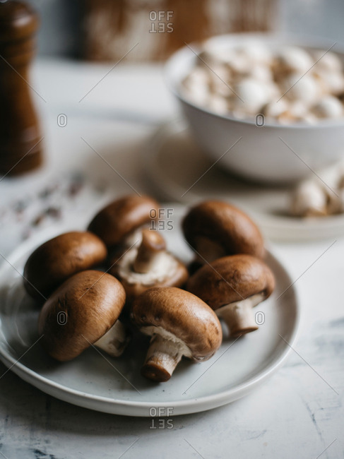 Raw champignons, king and small size mushrooms ready for cooking