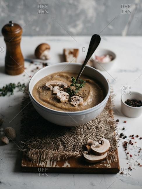 Creme of mushroom soup in white ceramic bowl