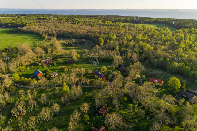 Aerial view village surrounded by fields on Forby on Vormsi island, Estonia.