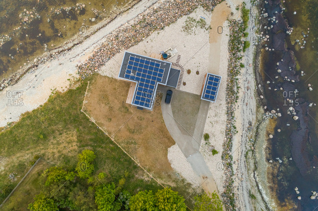 Aerial view of an isolated house with solar energy in the edge of a forest in Estonia.