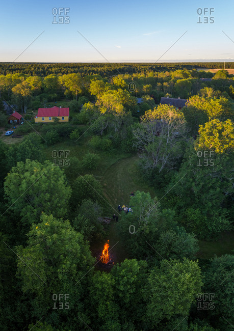 Aerial view village surrounded by fields with a fire pit on Forby on Vormsi island, Estonia.