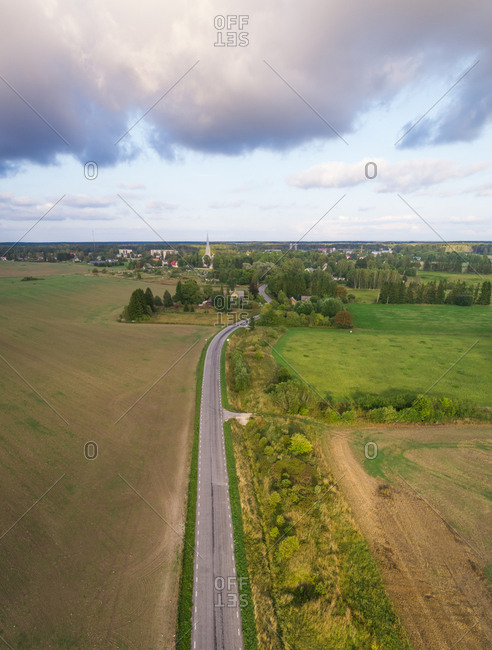 Aerial view road going through field in direction of Riisipere, Estonia.