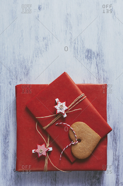 Wrapped Christmas presents on wooden background